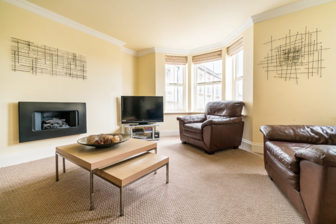 The Landings, Whitby. Large living room with flat screen television and leather sofas