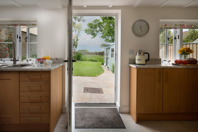 A beautiful view frok the kitchen over to the sea