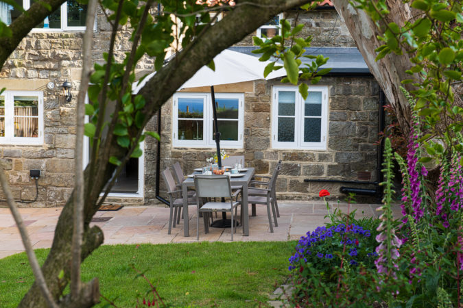 Eat al fresco in this wonderful garden at Chapel Cottage in Lythe