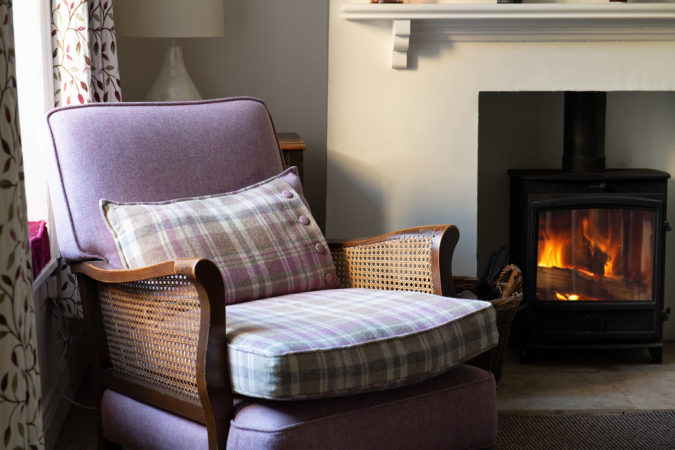 Warm and cosy in front of the log burning stove in winter months